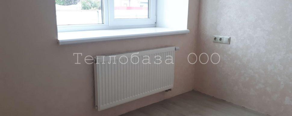 радиатор под окном комнате