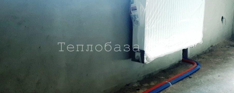 радиатор с нижним подключением под окном