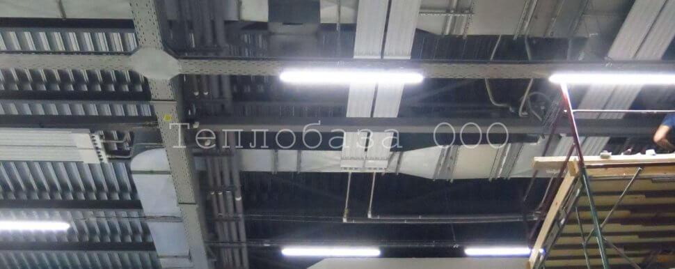 монтаж инфракрасных панелей над потолком здания